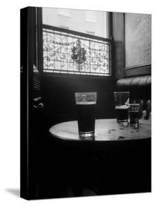 Half Empty Glasses of Beer Left on Table in the Blue Lion Pub in Dublin by Gjon Mili