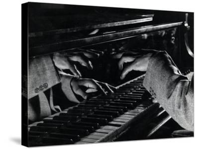 Hands of Jazz Pianist Eddie Heywood on Keyboard During Jam Session