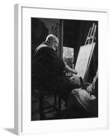 Henri Matisse at His Easel, Drawing from Live Model