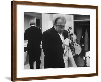 Isaac Stern Wiping His Violin Backstage
