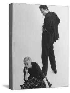 Italian Director Federico Fellini and Actress Wife Giulietta Masina Posing in Studio by Gjon Mili