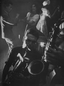 Jitterbugging at La Rose Rouge, with Saxophones Being Played in Foreground by Gjon Mili