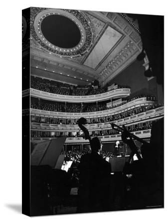 Leopold Stokowski Conducting the New York Philharmonic Orchestra in Performance at Carnegie Hall