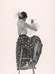 Model Dorian Leigh Wearing White Organdy Shirt with Full Print Skirt by Ceil Chapman by Gjon Mili