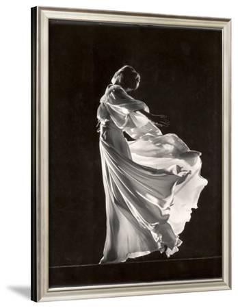 Model Posing in Billowing Light Colored Sheer Nightgown and Peignoir
