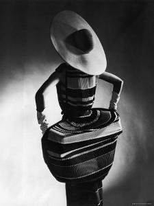 Model Showing Off Mushroom Pleats in the Slim Sheaths by Gjon Mili