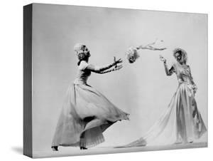 Model Wearing Wedding Gown Tossing Bouquet to Another Model Dresses as Bridesmaid by Gjon Mili
