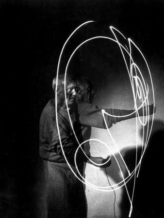 Multiple Exposure of Artist Pablo Picasso Using Flashlight to Make Light Drawing in the Air