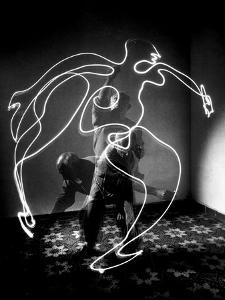 Multiple Exposure of Artist Pablo Picasso Using Flashlight to Make Light Drawing of a Figure by Gjon Mili