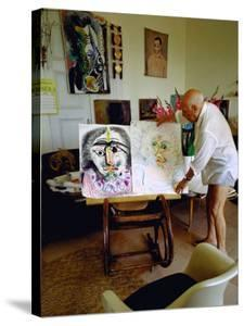 Pablo Picasso Arranging Displays of His Paintings at His Home in Notre-Dame-De-Vie, Mougins by Gjon Mili