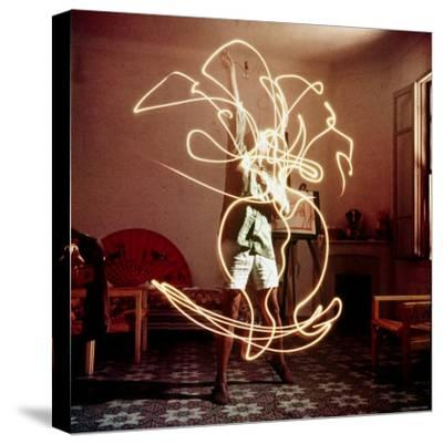 Pablo Picasso Creating Light Drawing of Vase of Flowers, Alone