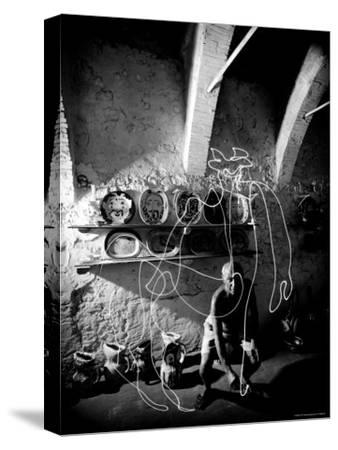Pablo Picasso Drawing a Centaur in the Air with a Flashlight at Madoura Pottery