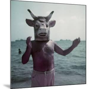 Pablo Picasso Wearing a Cow's Head Mask on Beach at Golfe Juan Near Vallauris by Gjon Mili