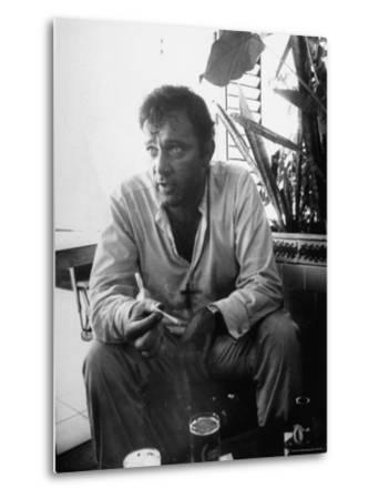 Richard Burton Relaxing in Cantina on Location