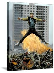 Riff Leaps over Smoldering Rubble of New York Slum Clearance Project in Scene from West Side Story by Gjon Mili