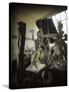 Russian Sculptor Ossip Zadkine Sitting in His Paris Studio Among Towering Sculptures by Gjon Mili
