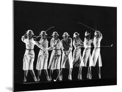Saks Fifth Avenue Fashion Shot of Model Swinging Golf Club
