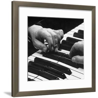The Hands of Pianist Josef Hofmann on Piano Keyboard