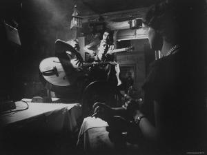 Two Guitarists and Vocalist Entertaining at Club Chez Genevieve by Gjon Mili