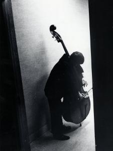 Young Bassist Member of Alexander Schneider's New York String Orchestra Tuning His Instrument by Gjon Mili