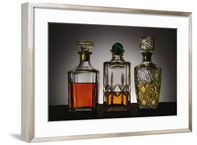 Glass and Crystal Decanters Containing Brandy and Whiskey-Paul Damien-Framed Photographic Print