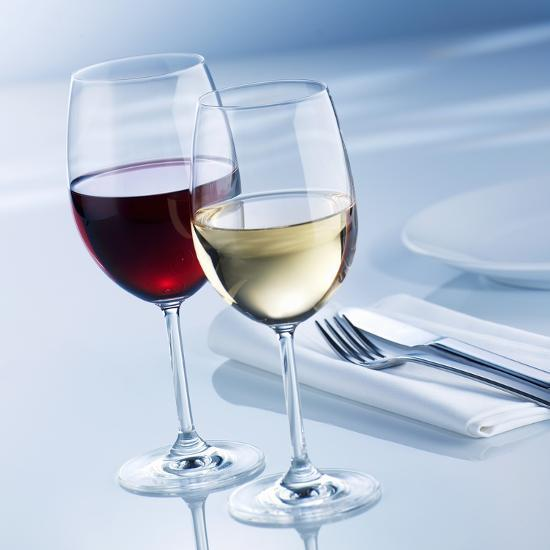 Glass of White Wine and Glass of Red Wine Beside Place-Setting-Alexander Feig-Photographic Print