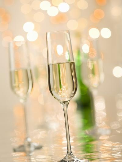 Glasses of Sparkling Wine with Twinkling Lights-Brigitte Protzel-Photographic Print