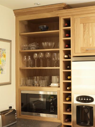 Glassware Displayed in Shelving Unit in Kitchen with Wood Fitted Units-Oliver Beamish-Photo