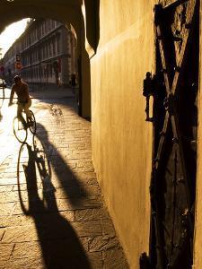 Early Morning Cyclist in Innsbruck's Altstadt (Old Town), Innsbruck, Austria by Glenn Beanland