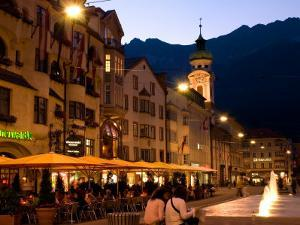 People Relaxing Along Maria Theresien Strasse, Innsbruck, Austria by Glenn Beanland
