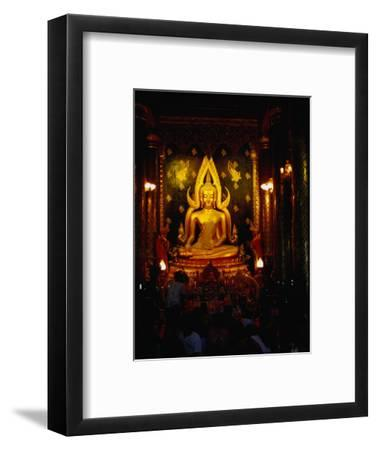 Worshippers in Front of Chinnarat Buddha in Wat Phra Si Ratana Mahathat, Phitsanulok, Thailand