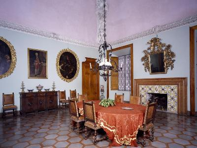 Glimpse of Dining Room with Furniture and Fireplace by Alberto Oliva--Giclee Print