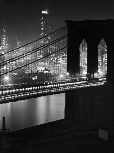 Glittering Night View of the Brooklyn Bridge Spanning the Glassy Waters of the East River-Andreas Feininger-Photographic Print