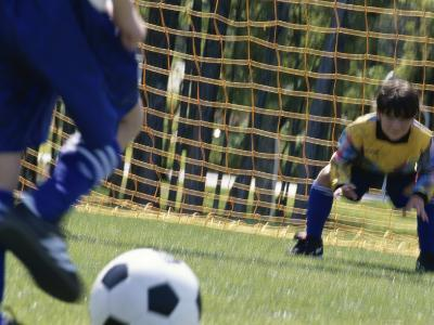 Goalie Attempting to Stop a Soccer Ball--Photographic Print