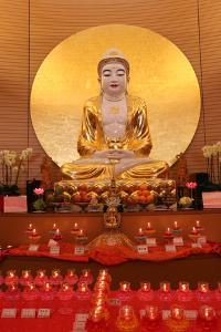 Buddha statue on main altar in Buddha Hall, Fo Guang Shan Temple, Geneva, Switzerland by Godong