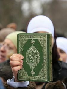 Koran Being Held During a Muslim Demonstration, Paris, France, Europe by Godong