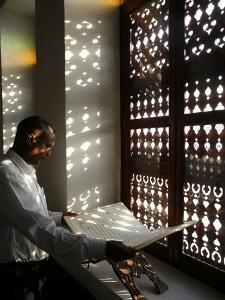 Man Reading the Koran in a Doha Mosque, Doha, Qatar, Middle East by Godong