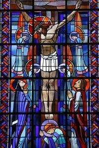 Stained glass of the Crucifixion in Notre Dame du Rosaire Catholic church, Saint-Ouen by Godong