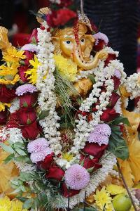 Statue of the Hindu God Ganesh with Garlands, Paris, France, Europe by Godong