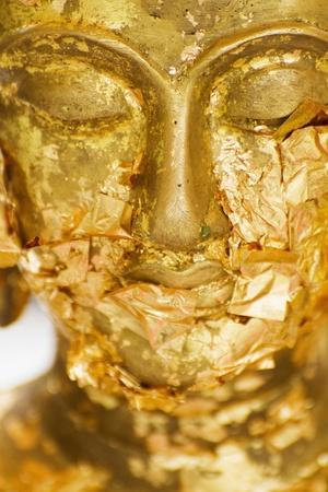 https://imgc.artprintimages.com/img/print/gold-leaf-offerings-on-statue-at-wat-phra-kaew-temple_u-l-pu692s0.jpg?p=0