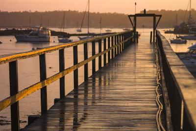 Golden Sunlight on a Pier, Boats, and Water at Sunset-Jonathan Irish-Photographic Print