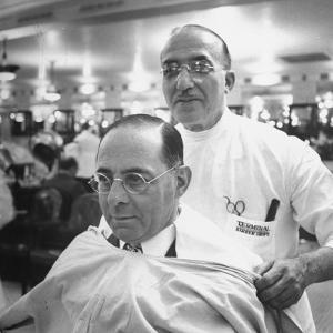 Goldman Sachs and Co. Partner Sidney Weinberg Sitting in Chair at Barber Shop