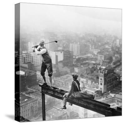 Golfer Teeing off on Girder High above City
