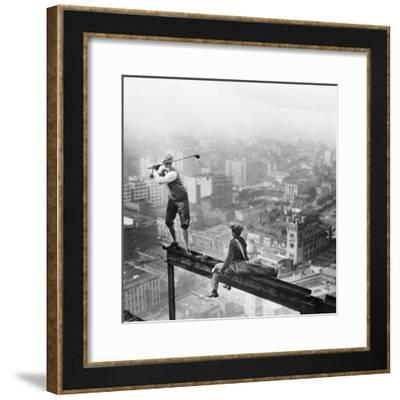 Golfer Teeing off on Girder High above City--Framed Photographic Print