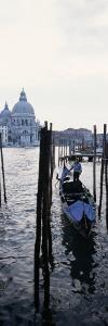 Gondolier in Gondola with Cathedral in Background, Santa Maria Della Salute, Venice, Veneto, Italy