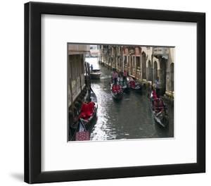 Gondolieres Row a Venice Canal