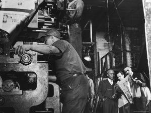 Man Working Newspaper Printing Press at Chicago Defender While Founder Robert S Abbott Checks Copy by Gordon Coster