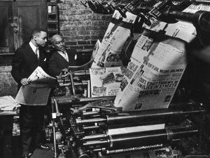 Newspaper Founder Robert S. Abbott Checking Printing Press at the African American Newspaper by Gordon Coster