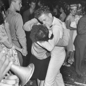 Sailor Kissing Pretty Girl amidst Jubilant Crowd in Celebration Regarding the End of WWII by Gordon Coster