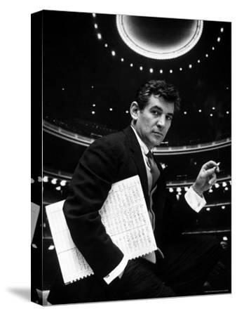 36 Year Old Composer Leonard Bernstein, Holding Musical Score with Lighted Auditorium Behind Him